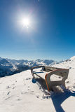 Bench in ski resort Bad Gastein in winter snowy mountains, Austria, Land Salzburg Stock Photo