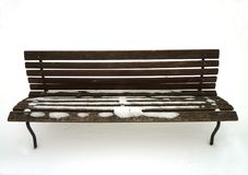 Bench in the snow. Wooden bench in the snow in the city park Royalty Free Stock Photography