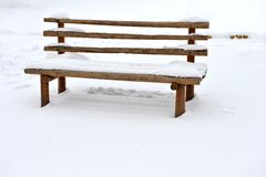 Bench in snow Royalty Free Stock Image