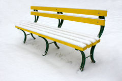 Bench in the snow Royalty Free Stock Images
