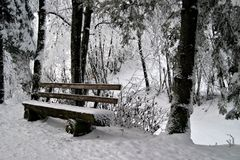Bench in Snow. Wooden bench in snow royalty free stock photos