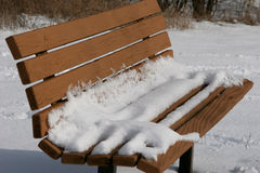 Bench with Snow. Snow covered park bench Royalty Free Stock Images