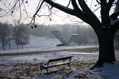 Bench in snow park Stock Image