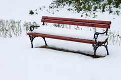 Bench in snow Stock Images