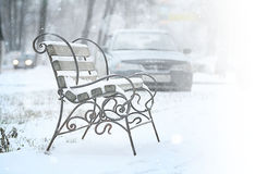 Bench in  snow park Royalty Free Stock Photography