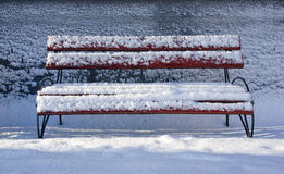 Bench with snow in the winter Stock Photo