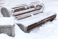 Bench in the snow Royalty Free Stock Photography