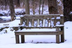 Bench in Snow. Wooden bench in snow Royalty Free Stock Images