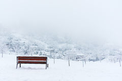 Bench and snowy winter landscape Royalty Free Stock Image