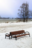 Bench in snowy winter scenery Royalty Free Stock Image