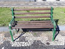 A bench in the square. A well-painted iron bench in a beautiful square royalty free stock images