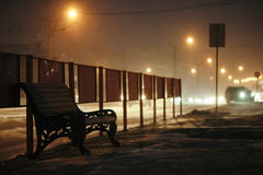 Bench stands near the roadway. Stock Photo