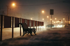 Bench stands near the roadway. Royalty Free Stock Images