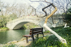 Bench and stone bridge on West Lake Royalty Free Stock Images