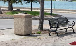 Bench And Stone Trash Receptacle Stock Photos