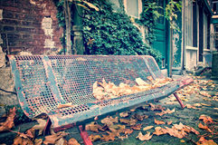 Bench in a street in autumn Stock Photo