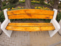 Bench in the street close up. With wide angle distorsion view royalty free stock photography