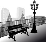 Bench and street lamp in city Stock Photo