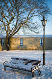 Bench and street lamp in the park winter Old Tallinn Royalty Free Stock Image