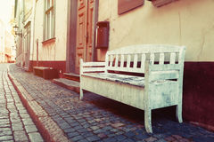 Bench on street in old city of Riga, Latvia Royalty Free Stock Image
