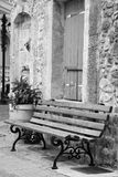Bench on the street in the old part of Malia. Bench on the street in the old part of Malia on Crete island, Greece. Black and white Royalty Free Stock Photos