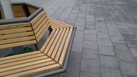 Bench on the street Stock Images