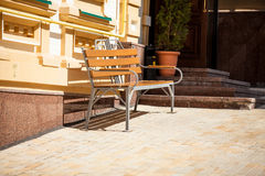 Bench on street at sunny day Stock Photos