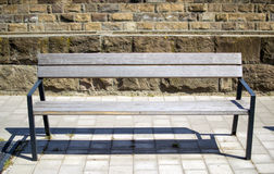 Bench in street. Wooden seat bench in city street Hungary Eger Stock Photography