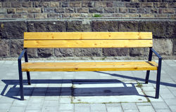 Bench in street. Wooden seat bench in city street Hungary Eger Stock Photos