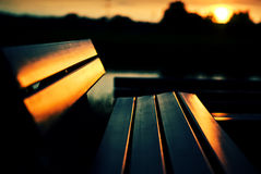 Bench at sunset. The Picture shows a bench at sunset stock photography