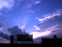 Bench in sunset. Taken at singapore lower pierce reservoir, old looking bench. dated 16 june 2006 Royalty Free Stock Images