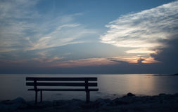 Bench at sunset in Croatia. Bench by the sea at sunset in Croatia - Umag Royalty Free Stock Photo