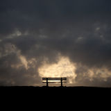 Bench in the sunset on a dike at the northsea Royalty Free Stock Photography