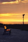 Bench at sunset near the sea Royalty Free Stock Images