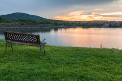 Bench by sunset over the sea royalty free stock photo