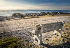 A bench a sunset. A bench on a path at sunset Stock Photography