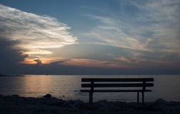 Bench at sunset. Bench by the sea at sunset in Croatia - Umag Stock Photo