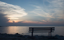 Bench at sunset in Umag. Bench by the sea at sunset in Croatia - Umag Royalty Free Stock Images