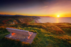 Bench at sunset with view of Azkorri beach in Getxo. Bench at the sunset with view of Azkorri beach in Getxo stock image