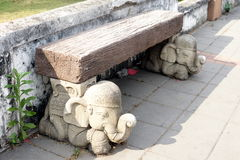 Bench Supported by Elephants Stock Photography