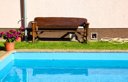 Bench and Swimming Pool Royalty Free Stock Photo