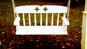 Bench swing swinging and fallen leaves halloween stock video footage