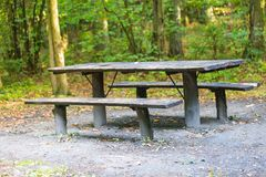 Bench and table in forest. Place for resting for tourists. Stock Photography