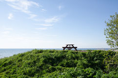 Bench and table at seaside Royalty Free Stock Photography