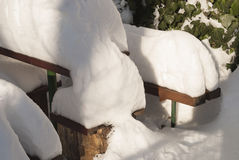 Bench, table and snow Royalty Free Stock Photos