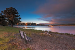Bench by Te Anau Lake, New Zealand in the morning Royalty Free Stock Photo
