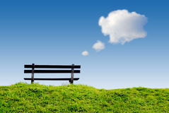 Bench with text balloon clouds Royalty Free Stock Images