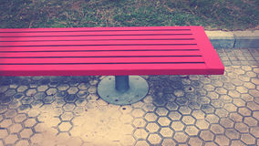 The Bench of Time. Background image red bench on street Royalty Free Stock Photo