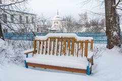 Bench to rest covered with snow Stock Image