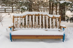 Bench to rest covered with snow Royalty Free Stock Photo